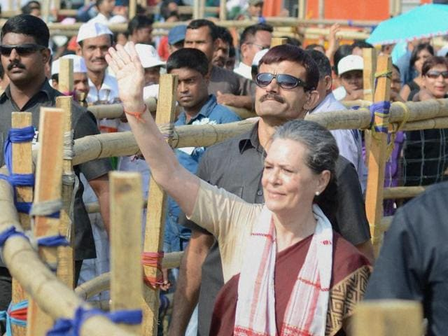 Congress president Sonia Gandhi waves at the crowd at an election rally at Biswanath Chariali in Sonitpur district, Assam.