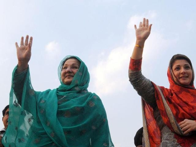 Daughter of Pakistan's Prime Minister Nawaz Sharif Maryam Nawaz (R) and her mother Kulsoom Nawaz wave to supporters in Lahore. Sharif's family was defiant on Monday, defending their ownership of offshore companies after they were named in the Panama Papers.