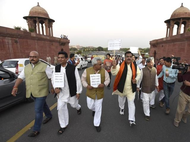 BJP MPs and MLAs from Uttarakhand outside Rashtrapati Bhawan. In the latest instances, internal squabbles within the Congress led to constitutional breakdown in Arunachal Pradesh and Uttarakhand, forcing the Centre to impose President's Rule.