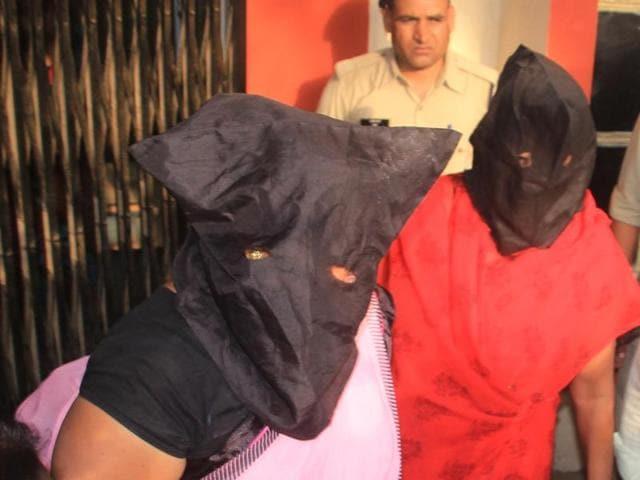 Vinita Bais and Suman Sharma in police custody in Indore on Monday.