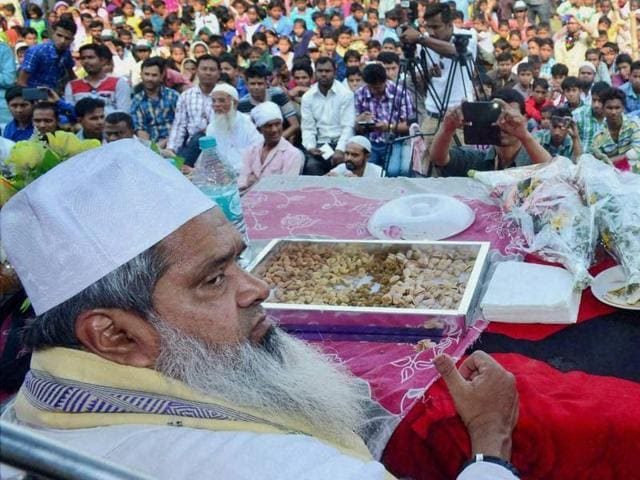 File photo of AIUDF chief Badruddin Ajmal (L) and AIUDF general secretary Aditya Langthasa (R) at an election rally at Jorsimulu village in Chaygaon assembly constituency in Assam.
