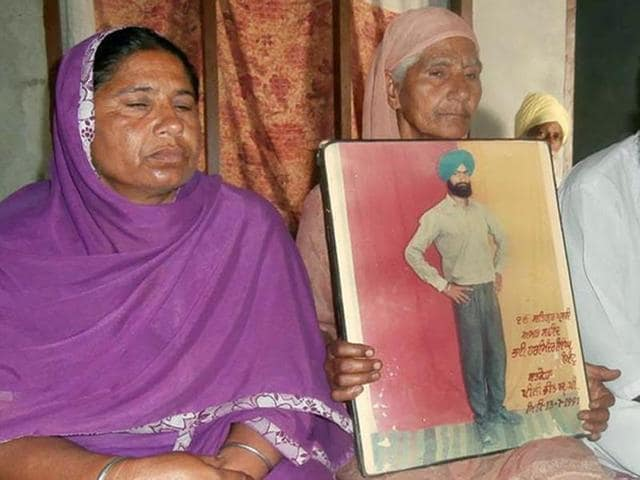 Swaranjeet Kaur of Satkoha village, who was left widowed after her husband Harminder Singh, aka Minta, was rounded up and killed along with 10 others while on way to Gurdwara Nanakmatta Sahib by the UP Police on July 12,1991.(HT Photo)