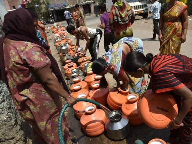 People gather to collect drinking water in Latur.