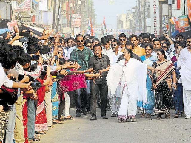 Kolkata: TMC workers carrying giant hoardings of West Bengal CM'Syndicate' is an extortion racket that runs in areas where real estate is witnessing a boom. Unemployed men backed by the ruling party use the clout and the threat of violence to force contractors into buying inferior building materials from them at a premium.