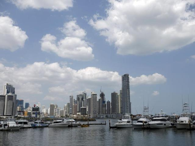 A yacht club is seen with city buildings in the background in Panama City.