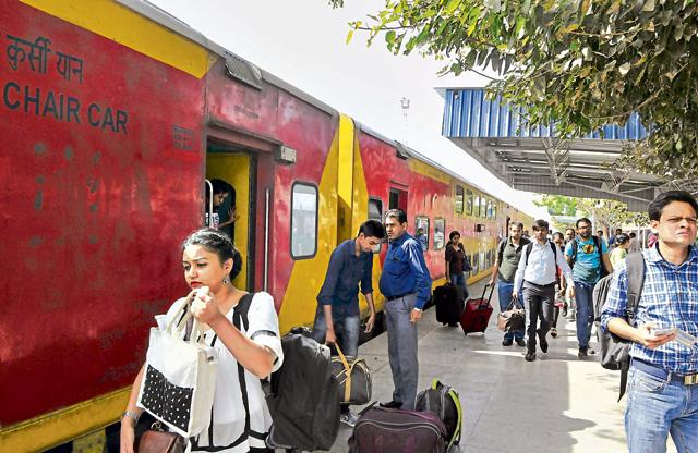 People opt for Double decker train for commuting to Jaipur and vice versa, at Gurgaon Railway Station.