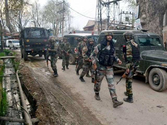 Army personnel moving towards the house where militants were hiding during an encounter at Gadoora village of Pulwama district of South Kashmir on Tuesday.