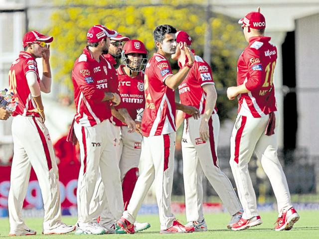 Students from La Trobe University work with team members of Kings XI Punjab (seen here during a match).