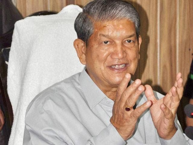 Former CM Harish Rawat addresses a press conference in Dehradun on Monday.