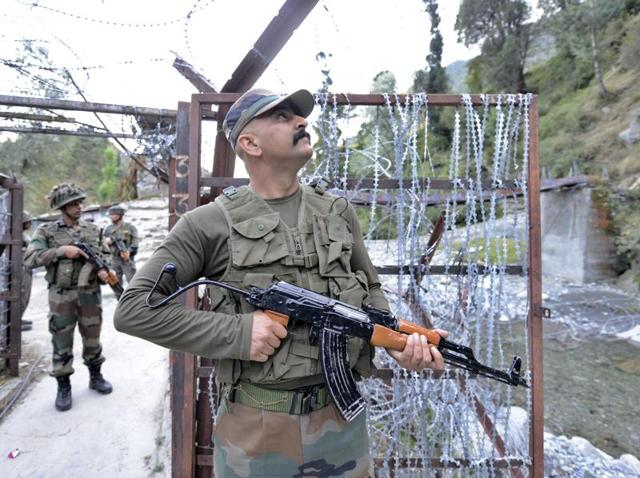 A soldier patrols near the Line of Control along the India-Pakistan border in Poonch district.