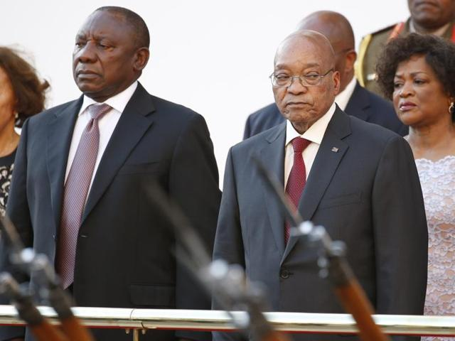 South Africa's Deputy President Cyril Ramaphosa and President Jacob Zuma stand during the playing of the national anthem at the opening of Parliament in Cape Town.