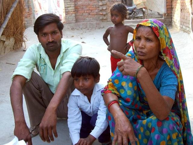 Kamla Devi with her son and grandchildren at her house in Rajapur in Lakhimpur Kheri district of Uttar Pradesh