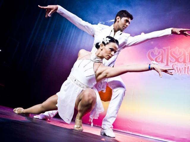 Dancers Neeraj and Gosia perform a synchronised Salsa movement.