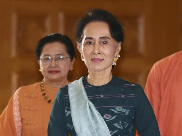 In this file photo, Myanmar's democracy icon Aung San Suu Kyi is seen with NLD members in Naypyidaw.