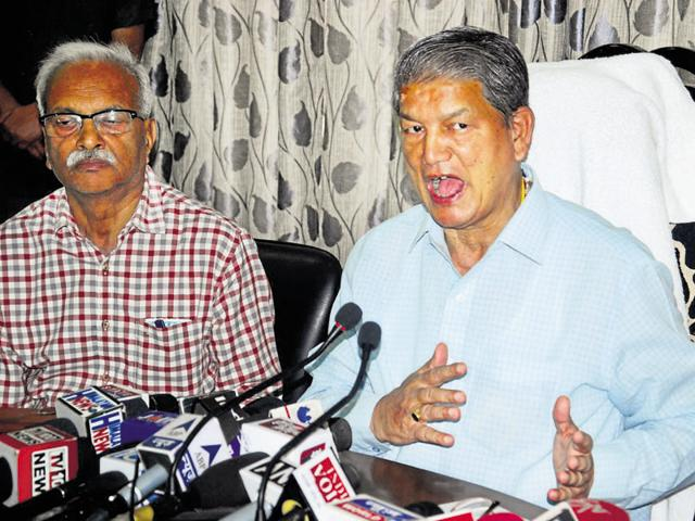 Former chief minister Harish Rawat addresses a press conference in Dehradun on Tuesday.