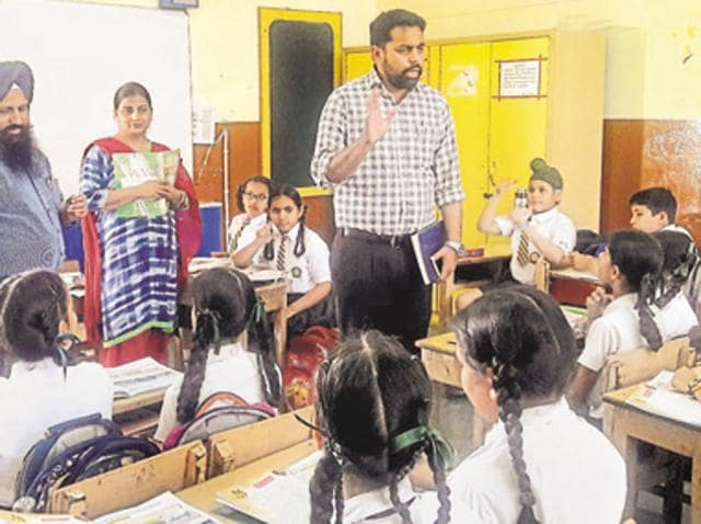 Officials talking to students at MGN Public School in Kapurthala on Tuesday.
