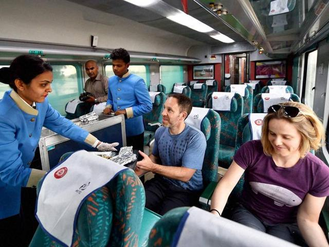 Passengers aboard the newly launched 'Gatimaan Express', India's first semi-high speed train, in New Delhi.