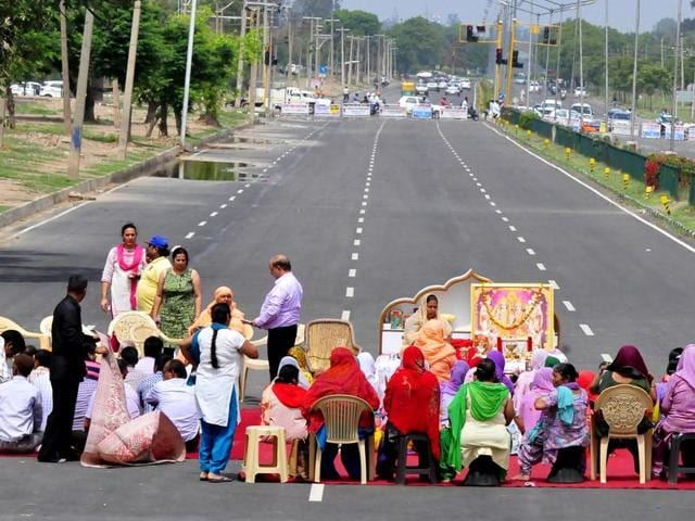 Protesters blocking highway between Sectors 45 and 50 in Chandigarh on Wednesday. Followers of the Shiv Shakti temple-cum-Nangli Ashram claimed it had been there for the past 40 years.