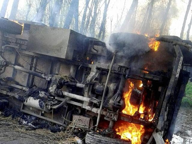 A  police vehicle  was set on fire by protesters near an encounter site in which two Hizbul Mujahideen militants militants  were killed at Shopian district of south Kashmir on Thursday, April 7, 2016.