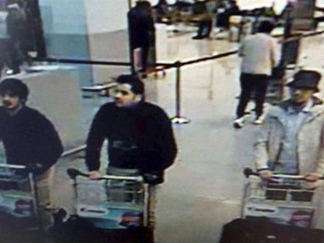 The newly released police video shows the man, wearing a dark hat and a light-coloured jacket, fleeing the airport's departure hall after the bombs went off at 7.58am on March 22.