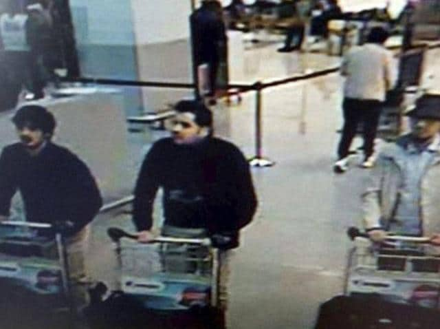 Three men who are suspected of carrying out attacks at Belgium's Zaventem Airport are pictured in this CCTVfootage provided by the Belgian Federal Police.