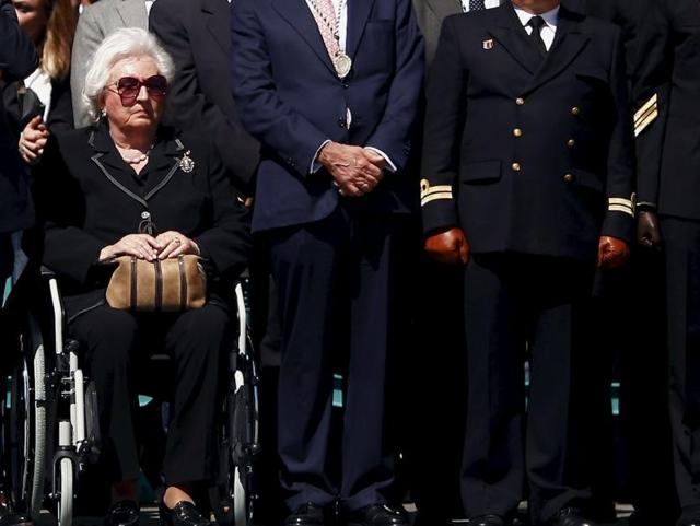 Spanish Infanta Pilar de Borbon (C), aunt of Spain's King Felipe, watches Spanish legionnaires carrying a statue of the Christ of Mena (not pictured) during a ceremony before