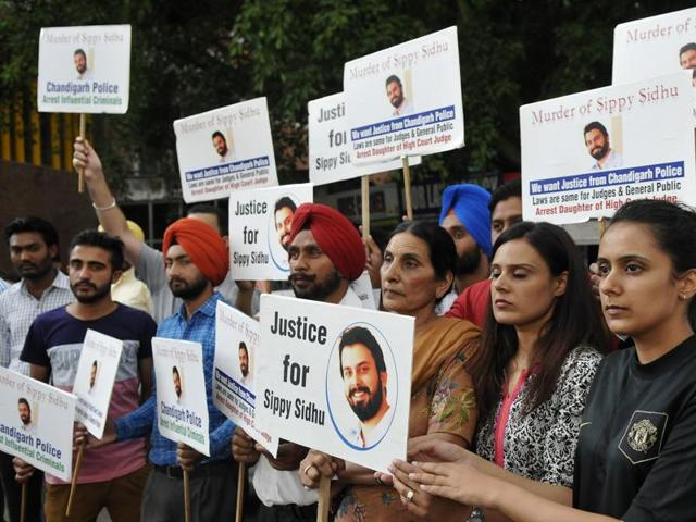 Family members of Sippy Sidhu holding a protest outside Punjab and Haryana High Court in Chandigarh on Thursday.