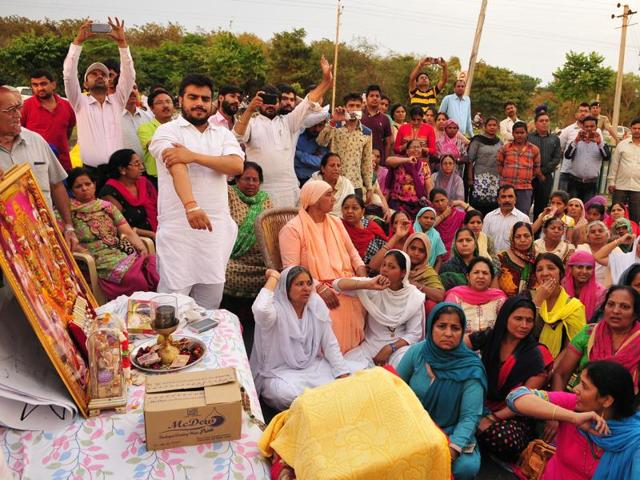 Devotees holding protest  against demolition of a  Nagli Ashram temple at Sector 50 in Chandigarh on Thursday.