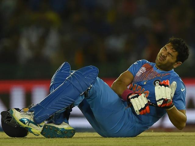 Yuvraj Singh grimaces in pain during the World T20 match against Australia.