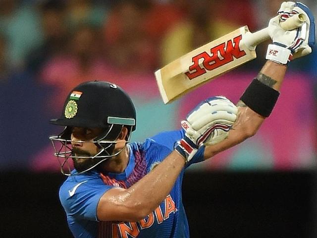 India's MS Dhoni, right, congratulates teammate Virat Kohli during their ICC World Twenty20.(AP Photo)