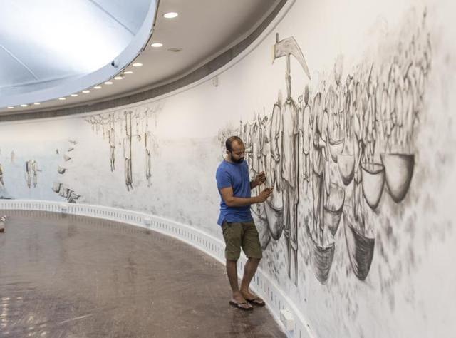 Artist Prabhakar Pachpute at work inside the National Gallery of Modern Art, Mumbai