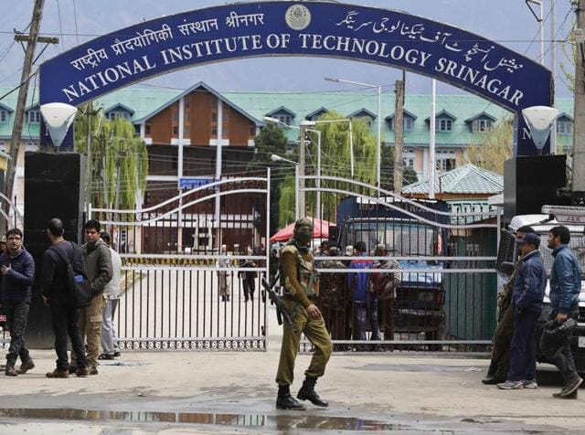 Indian security personnel guards the entrance to the National Institute of Technology (NIT), Srinagar.