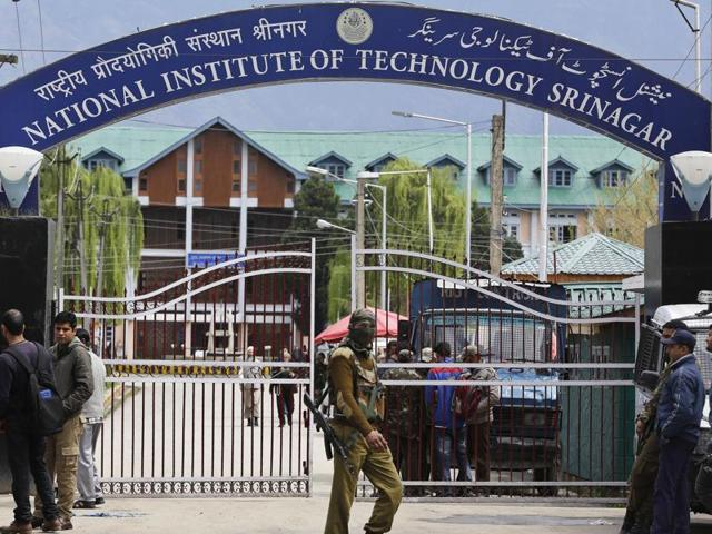 Security guards at the entrance of National Institute of Technology (NIT) Srinagar on Thursday. Classes had to be suspended after several students sustained injuries.