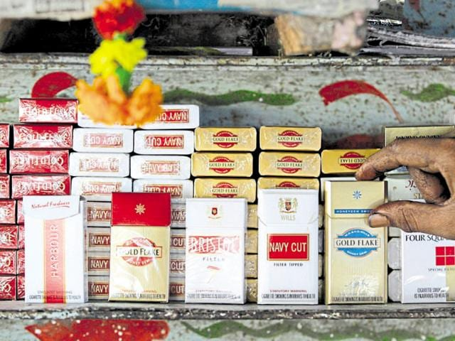Cigarette packets are displayed at a shop in Mumbai, India, Tuesday, Nov 27, 2007. Beedi manufacturers have joined cigarette makers in stopping production over new government rule that requires larger pictorial warning on packets.