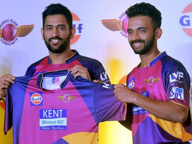 MS Dhoni launches the jersey of his new IPL team Rising Pune Supergiants along with teammate Ajinkya Rahane.