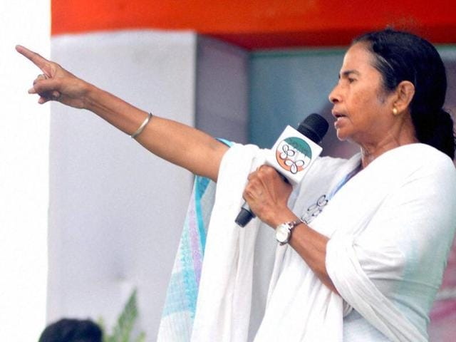 West Bengal chief minister Mamata Banerjee addresses an election rally with party candidate Niyamat Seikh, in Murshidabad.