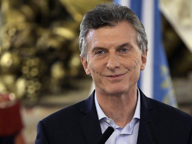 Argentine President Mauricio Macri arrives to deliver a speech at Casa Rosada Government Palace in Buenos Aires on April 7, 2016, after a prosecutor opened an investigation on his offshore financial dealings leaked in the Panama Papers. Macri said Thursday he made no