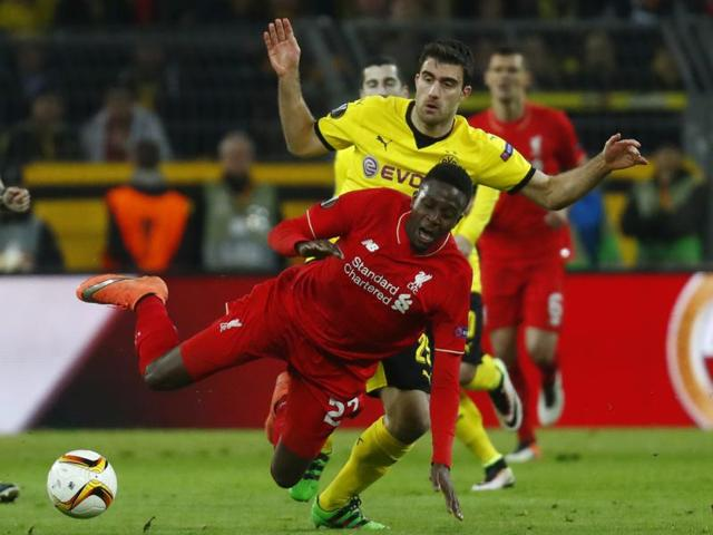 Borussia Dortmund's Marco Reus shoots from a free kick.