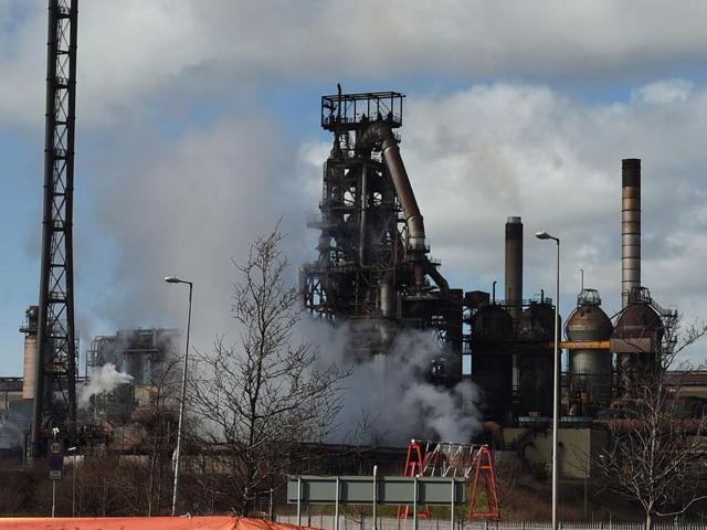 Banners supporting local steel workers are seen outside the Tata steel plant in Port Talbot, Wales.
