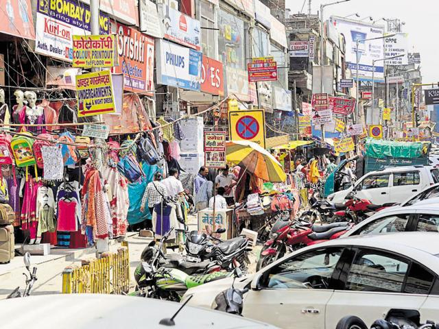 Hawkers, vendors and illegally parked vehicles have encroached upon the service lane in Atta market.