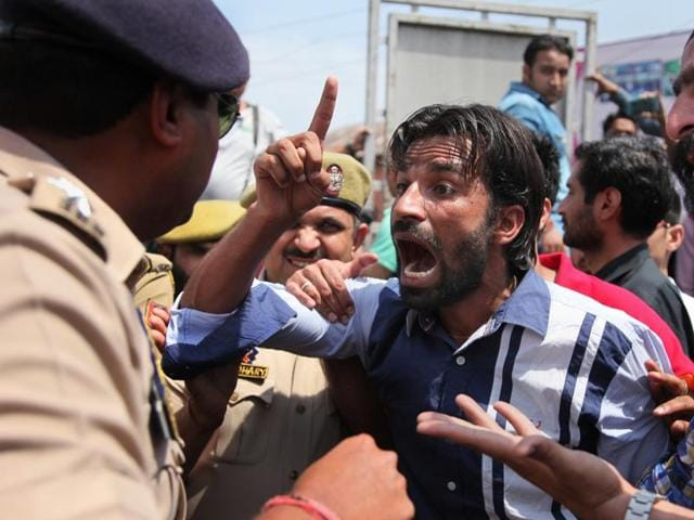 Students argue with a policeman during a protest against police action on students of National Institute of Technology (NIT) in Srinagar while they were protesting against students of Kashmiri origin celebrating India's loss to West Indies in the semifinal of the ICC T20 World Cup.