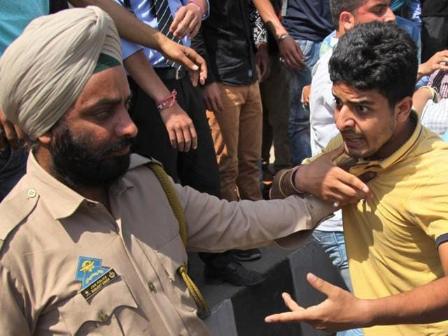 Students argue with a policeman during a protest against police action on students of National Institute of Technology (NIT) in Srinagar on Thursday.
