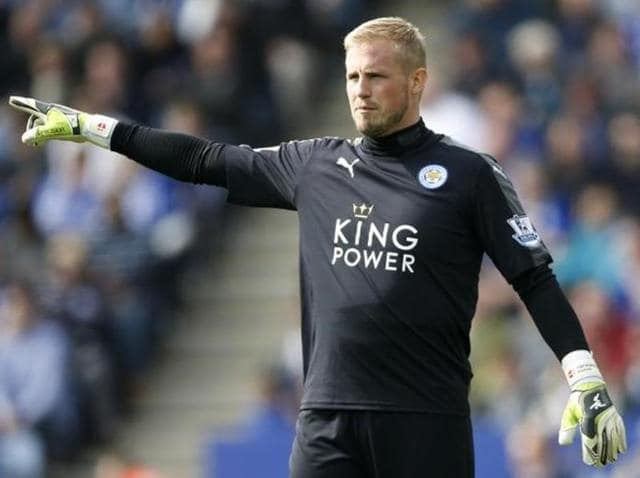 Leicester City's goalkeeper Kasper Schmeichel  celebrates with Leicester City's striker Jamie Vardy.