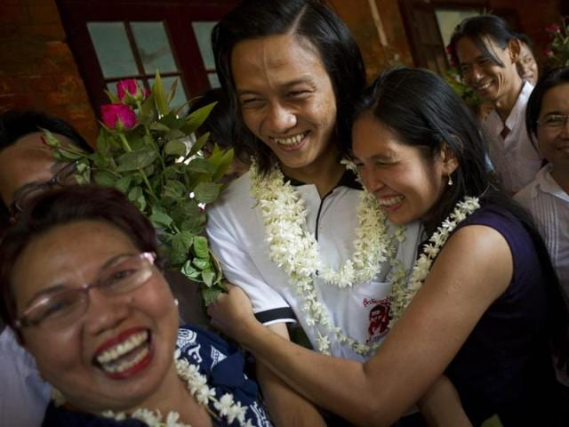 Family members welcome student protest leaders Nandar Sitt Aung (L) and Phyo Phyo Aung (R) as they arrives for a hearing at her trial in Tharrawaddy town, Bago Region in Myanmar on April 8, 2016.