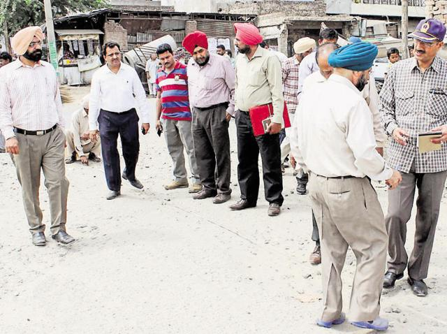 A vigilance team inspecting a road in Patiala on Thursday.
