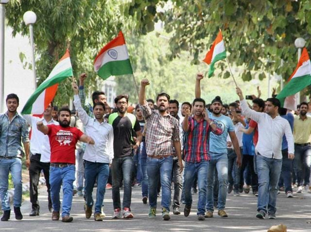 Jammu University students take out a rally to protest police action against non-Kashmiri students at NIT Srinagar on Thursday.