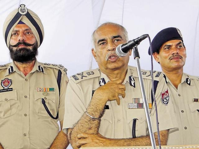 DGP Suresh Arora (centre) interacting with people at Daulewala village in Moga on Thursday.