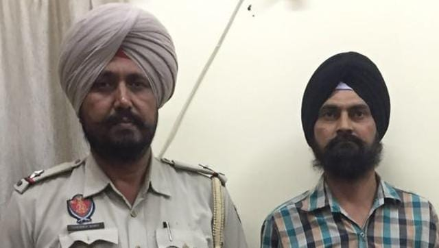 A sobered-up Harjinder Singh (right) in the Ludhiana police custody on Saturday.