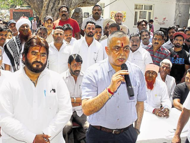 Chief parliamentary secretary KD Bhandari addressing the sanitation workers in Jalandhar on Friday.