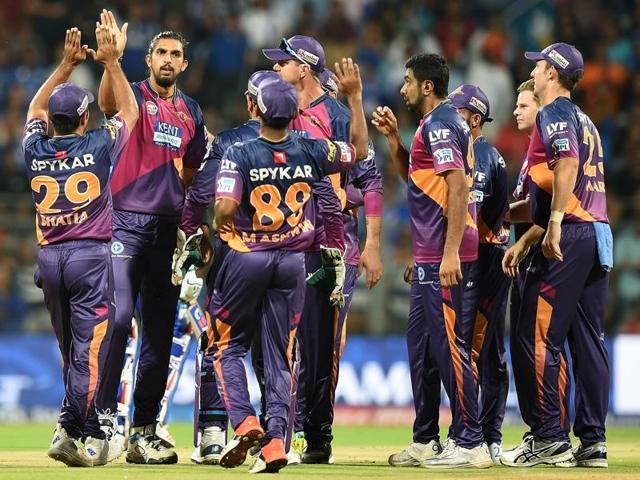 Ishant Sharma  celebrates with teammates after taking the wicket of Mumbai Indians batsman Rohit Sharma.